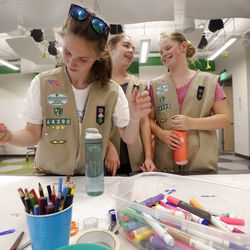 Girl Scouts Amelia Connolly, left, Ava Townsend and Maddie Hagenson start work on a project. | AP Photo