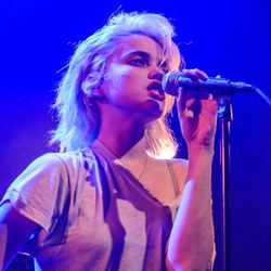"""Sky Ferreira in a destroyed tee. Image via <a href=""""http://www.brooklynvegan.com/chicago/pictures/"""">Brooklyn Vegan</a>."""