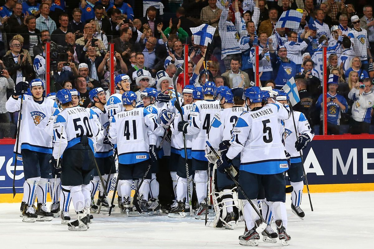 Finland celebrates a win over Slovakia in the 2013 IIHF World Championships Quarterfinal.