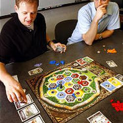 """Jeremy Young and Matt Molen play one of the games they created, """"Settlers of Zarahemla."""""""
