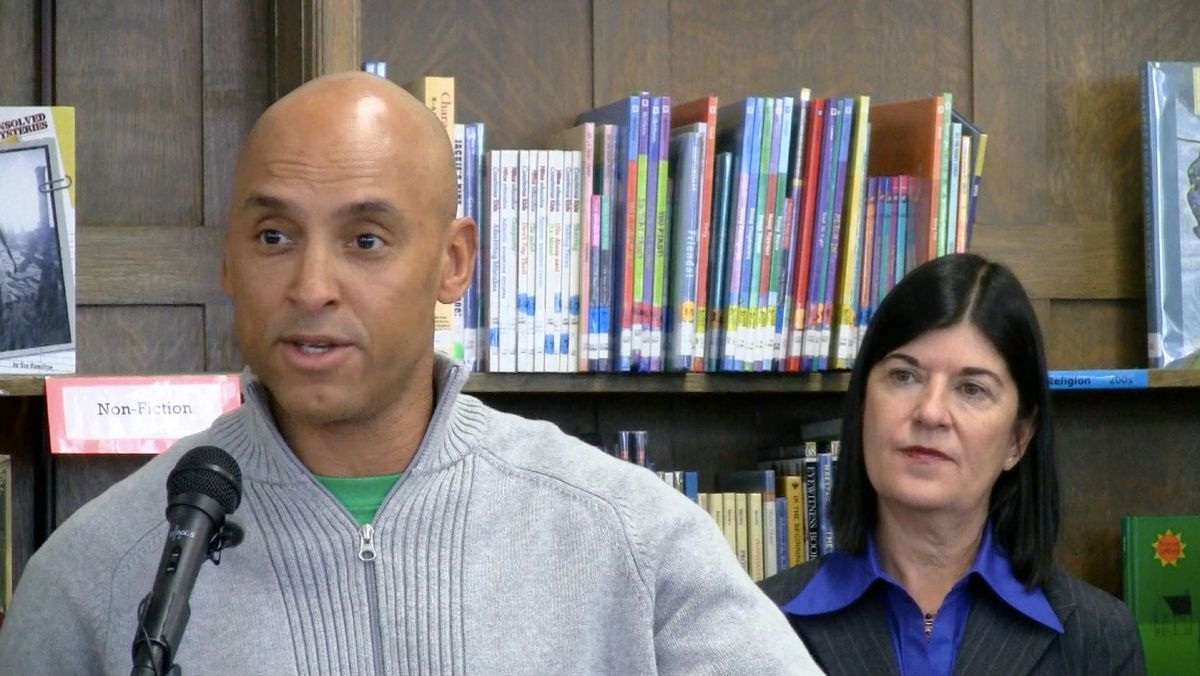Denver parent J.R. Lapierre, who hopes his two young sons will attend DSST charter, spoke at Tuesday's press conference on the DPS-Charter compact. To the right is Vicki Phillips with the Bill & Melinda Gates Foundation.