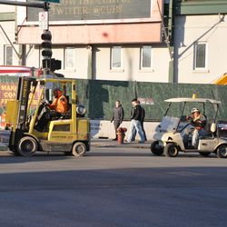 Forklift and work cart waiting to make a left turn at Addison and Clark. They were heading toward the Brown Lot -