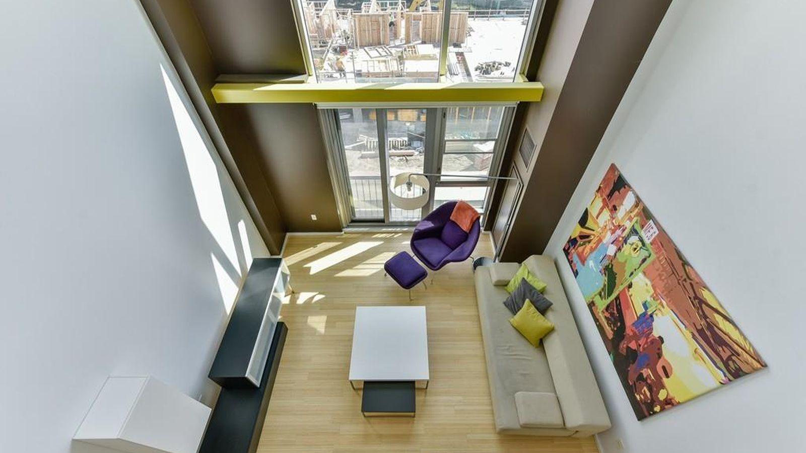 East Cambridge Loft Duplex Features Floor To Ceiling