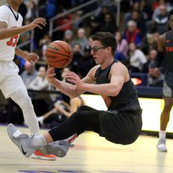 While falling, Evanston's Blake Peters (15) looks to pass against Oak Park in Oak Park,  Saturday, February 2, 2019. | Kevin Tanaka/For the Sun Times