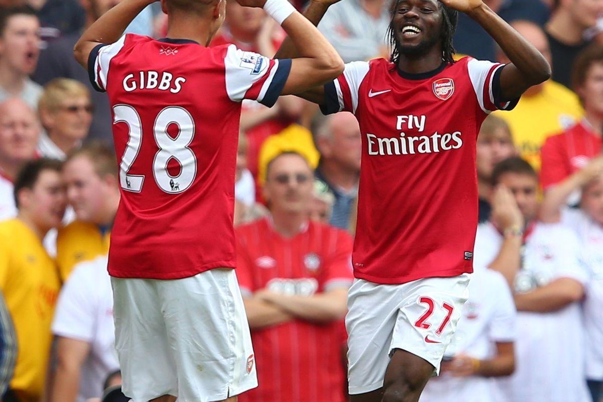 "Kieran Gibbs and Gervinho celebrate a goal neither of them really ""scored"""