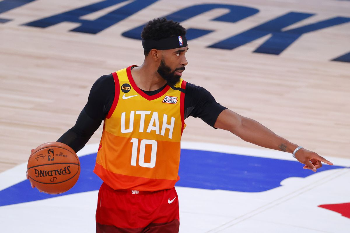 Mike Conley of the Utah Jazz sets up the play against the Denver Nuggets during the fourth quarter in Game Four of the Western Conference First Round during the 2020 NBA Playoffs at AdventHealth Arena at ESPN Wide World Of Sports Complex on August 23, 2020 in Lake Buena Vista, Florida