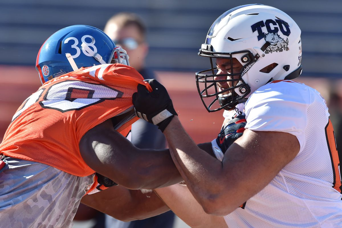 Mobile, AL, USA; South Squad outside linebacker Marquis Haynes of Ole  Miss (38) and offensive tackle Joe Noteboom of TCU (68) battle during  Senior Bowl practice at Ladd-Peebles Stadium.