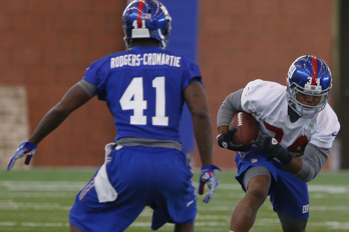 Dominique Rodgers-Cromartie and Shane Vereen work during OTAs.