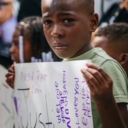 A boy stands with a sign during a demonstration on June 24, 2020 in St. Paul, Minnesota.