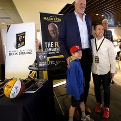 Mark Eaton poses for a photo with Drake Woolley, left, and Cabot Woolley after signing his new book for them at the Jazz 100 Club in Vivint Arena in Salt Lake City on Friday, March 30, 2018.