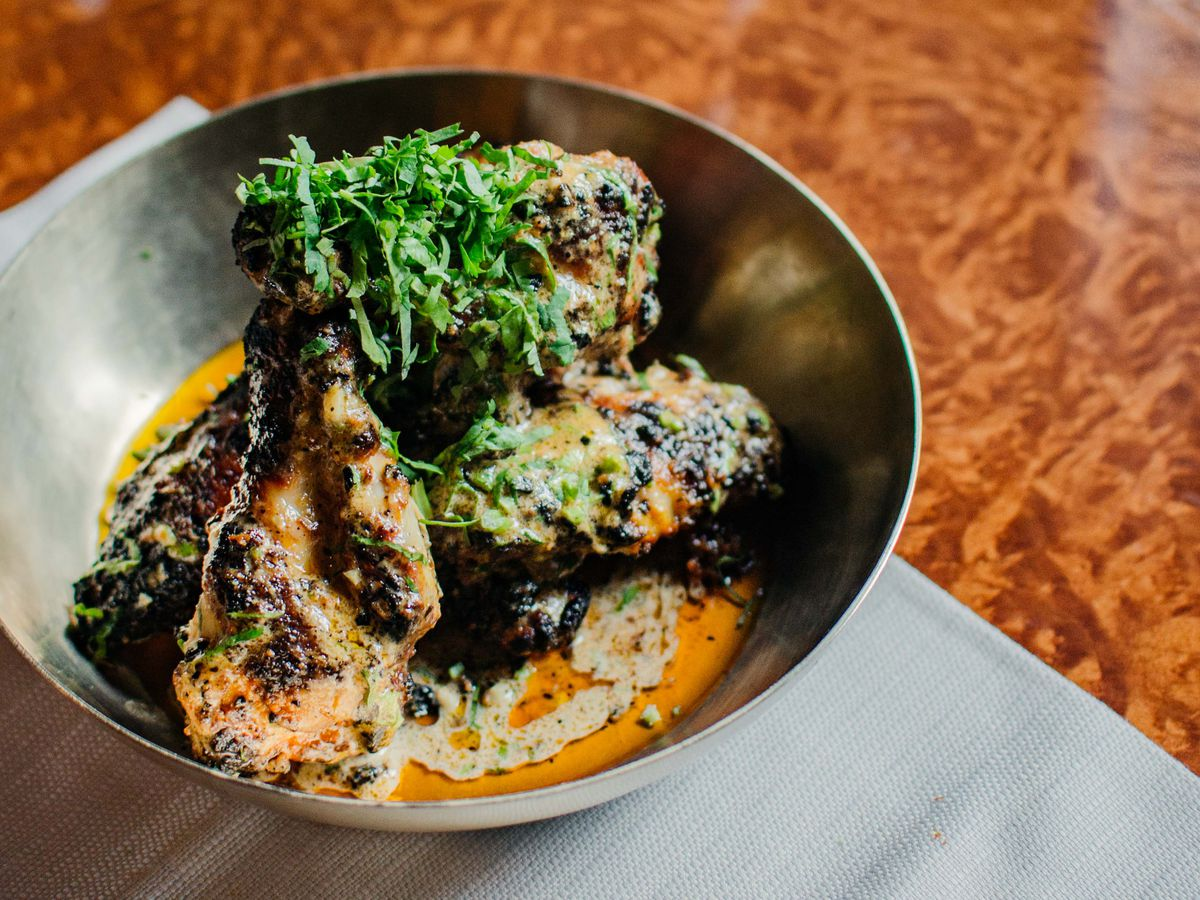 Butter chicken wings at Brigadiers, at the Bloomberg Arcade in the City —a restaurant by JKS, which runs Michelin-starred Trishna and Gymkhana, as well as Hoppers.