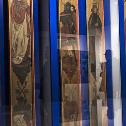 A visitor reflects in a shocase showing six panel of a private chapel in the Hardoerfer House of Nuremberg during the press preview of the national special exhibition 'Luther and the Germans' at the Wartburg Castle, where Martin Luther translated the New Testament to German, in Eisenach, Germany, Tuesday, May 2, 2017. The exhibition presents around 300 exhibits from the Wartburg Foundation collection or on loan from other German and international institutions. The exhibition starts on May 4, 2017 and lasts until Nov. 11, 2017.