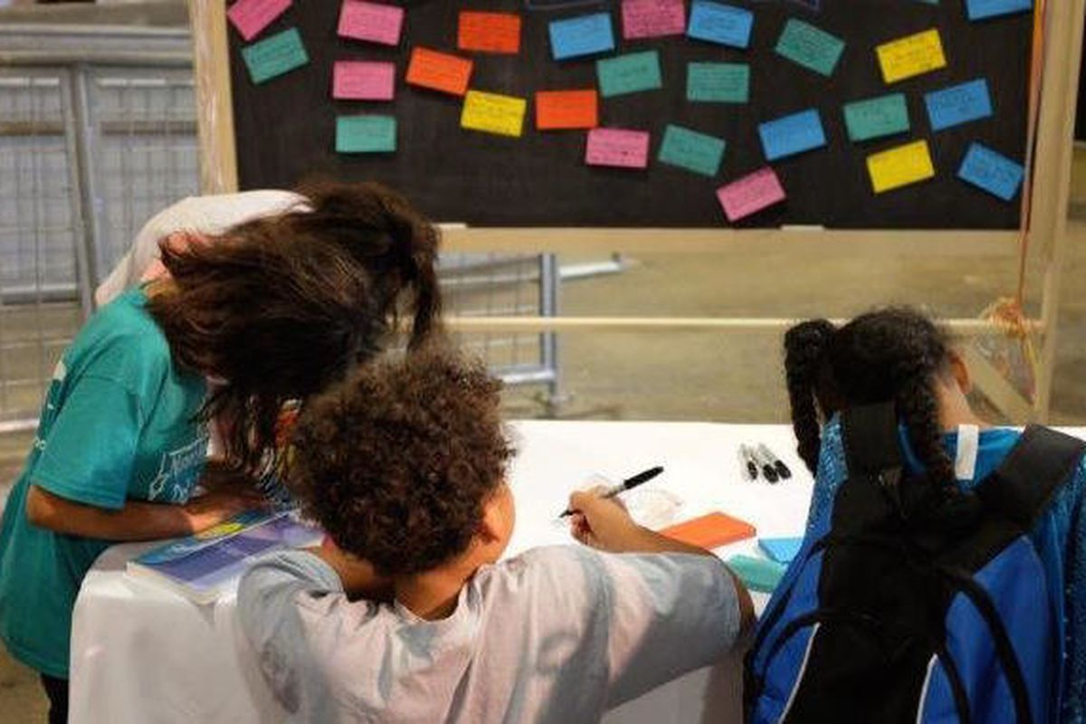 Attendees of all ages write thank-you notes to their favorite teachers.
