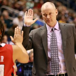 Utah's Ciera Dunbar gets a high five from head coach Anthony Levrets during a women's basketball game against BYU at the Marriott Center in Provo on Saturday, Dec. 14, 2013. Utah won in double overtime 82-74.