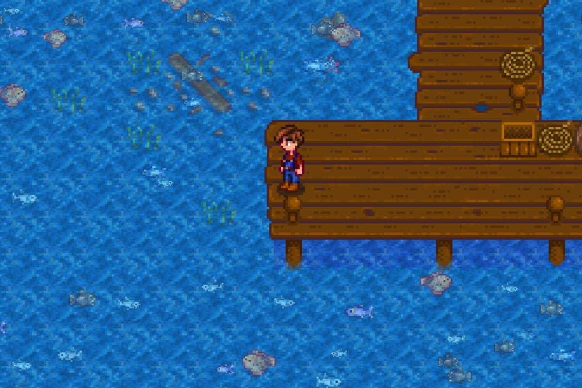A pixelated farmer fishes off a dock. there are tiny fish sprites in the water