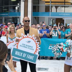 Jason Taylor unveils his place in the Miami Dolphins Walk of Fame on December 2, 2018 in a ceremony in the Joe Robbie Alumni Plaza at Hard Rock Stadium, Miami Gardens, Florida.