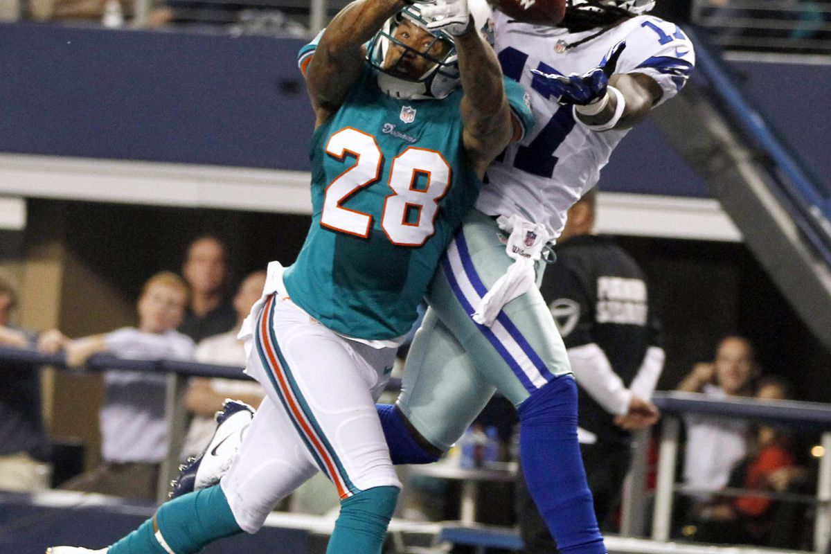 Randomly picked a picture for tonight's game.  Why not Nolan Carroll breaking up a Dallas pass.