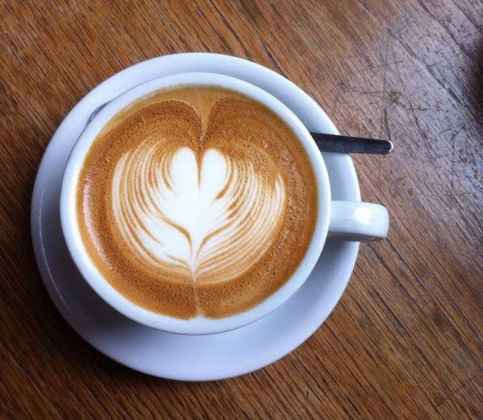 A cappuccino at Familia Cafe in Forest Gate E7
