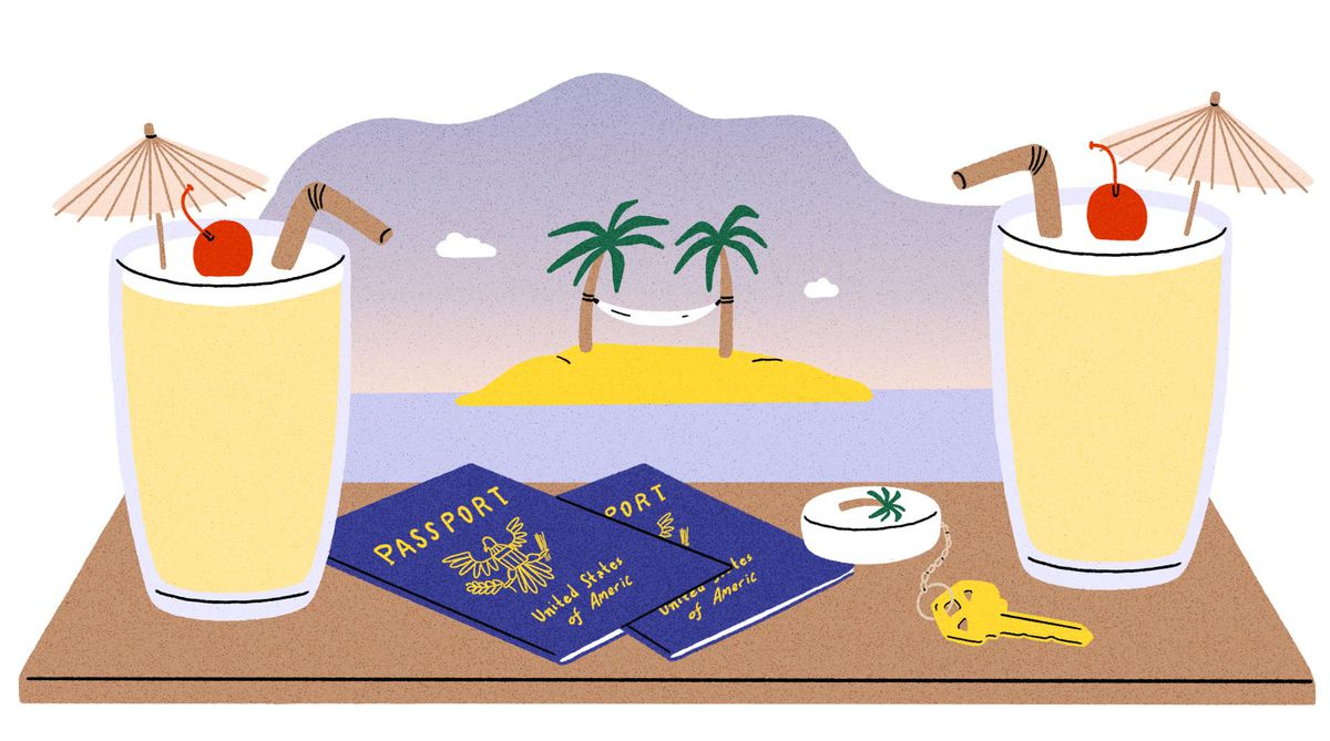 Two yellow tropical beverages with cherries and paper umbrellas sit on a brown surface next to a pair of passports and a key with a palm tree keychain. In the background there's a hammock strung between two palm trees on an island, overlooking the sunset.