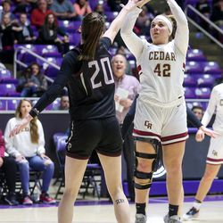 Cedar's Denim Henkel (42) attempts a 3-pointer against Pine View's forward Averi Papa (20) during the 4A girls championship basketball game at the Dee Events Center in Ogden on Saturday, Feb. 29, 2020.