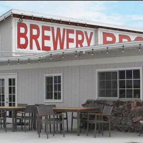 Exterior of restaurant Tecopa Brewing Company with sign reading Brewery BBQ in red lettering