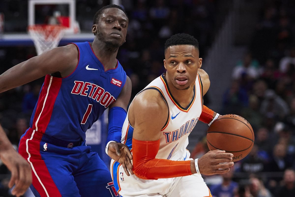 Oklahoma City Thunder guard Russell Westbrook defended by on Detroit Pistons guard Reggie Jackson in the first half at Little Caesars Arena.