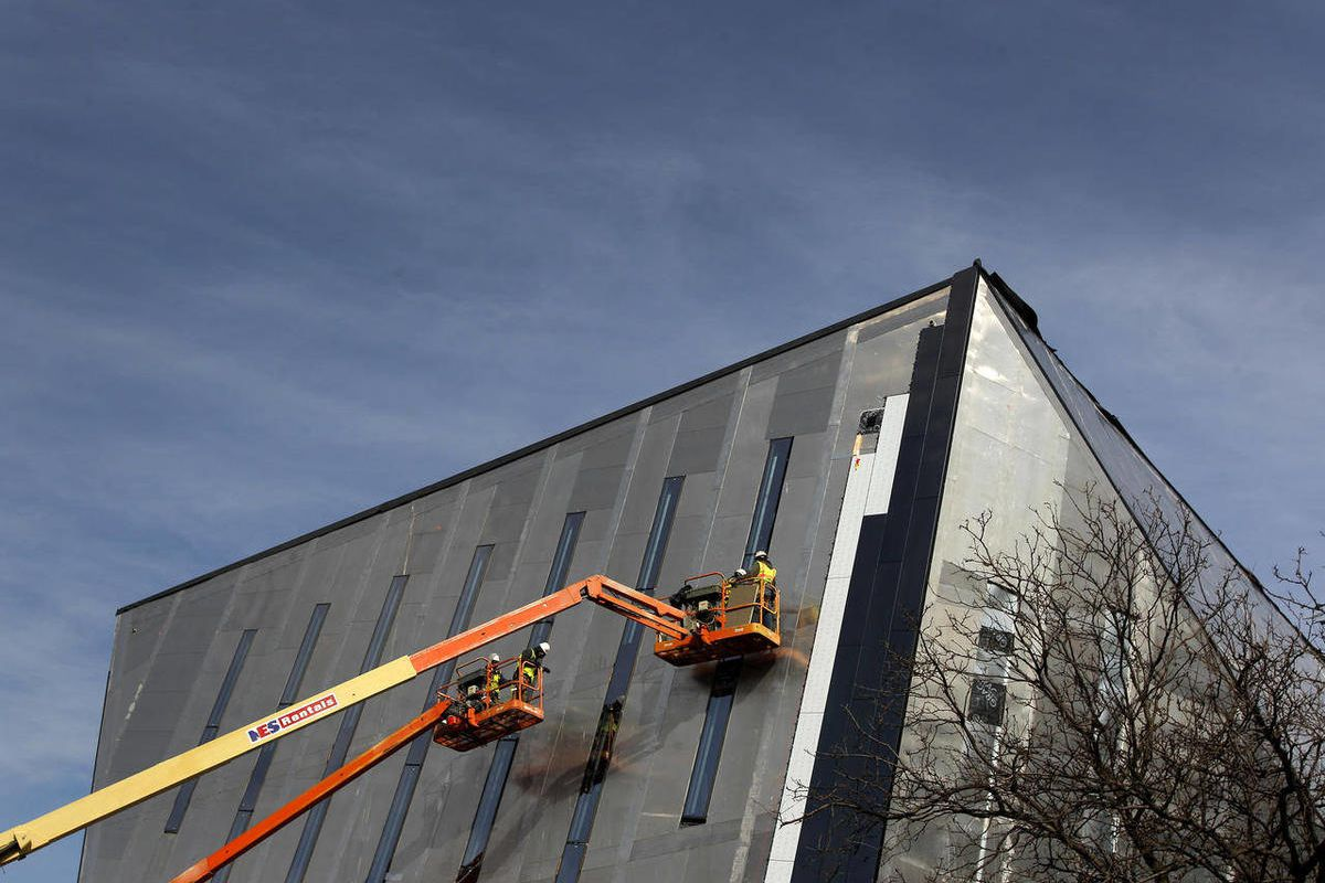In this Feb. 15, 2012 photo, people work on the side of the new Cleveland Museum of Contemporary Art in Cleveland. The building is expected to be done and open to the public in the Fall of 2012. The Commerce Department reported Monday, April 2, 2012, that