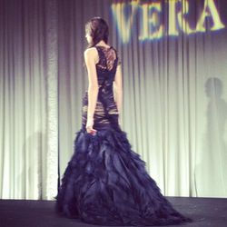 Black asymmetrically draped chiffon and French tulle mermaid gown.