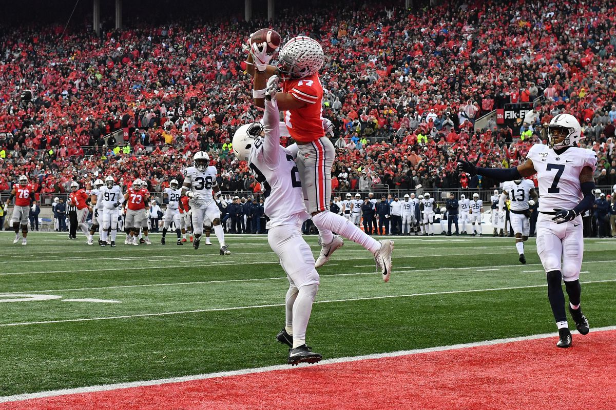Ohio State's Chris Olave soars for a touchdown catch in last year's win against Penn State.