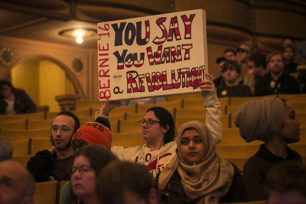 A Bernie Sanders' backer hoists a sign in the Auditorium Theatre. | Ashlee Rezin/Sun-Times