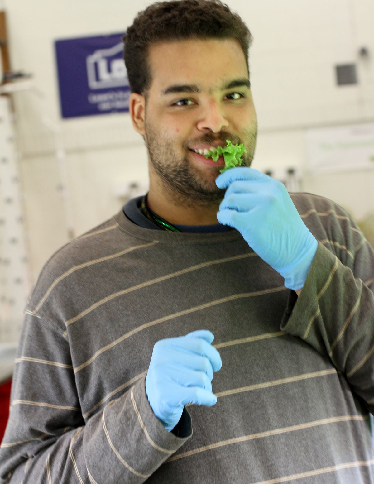 A student at Drew Transition Center samples some of the produce grown there.