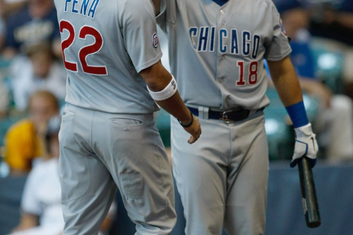 Carlos Pena of the Chicago Cubs is congratulated by Geovany Soto after scoring a run during a game against the Milwaukee Brewers at Miller Park in Milwaukee, Wisconsin. (Photo by Scott Boehm/Getty Images)