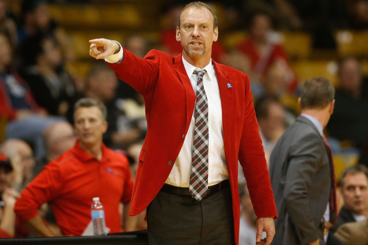 Utah head coach Larry Krystkowiak's red jacket retained its rivalry magic, and the Runnin' Utes elevated to No. 11 in this week's AP Poll.