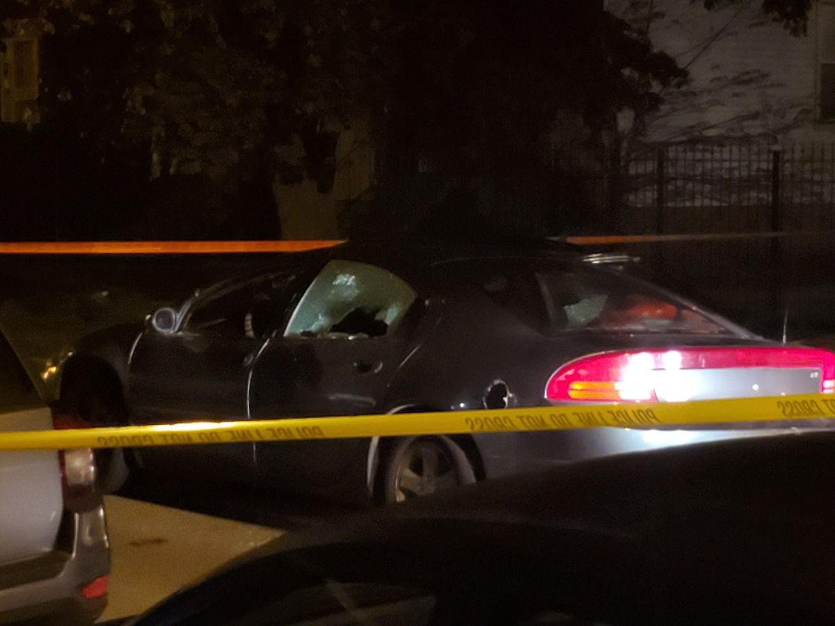 A car with the windows shot at 87th Street and Saginaw Avenue | Tyler LaRiviere/Sun-Times
