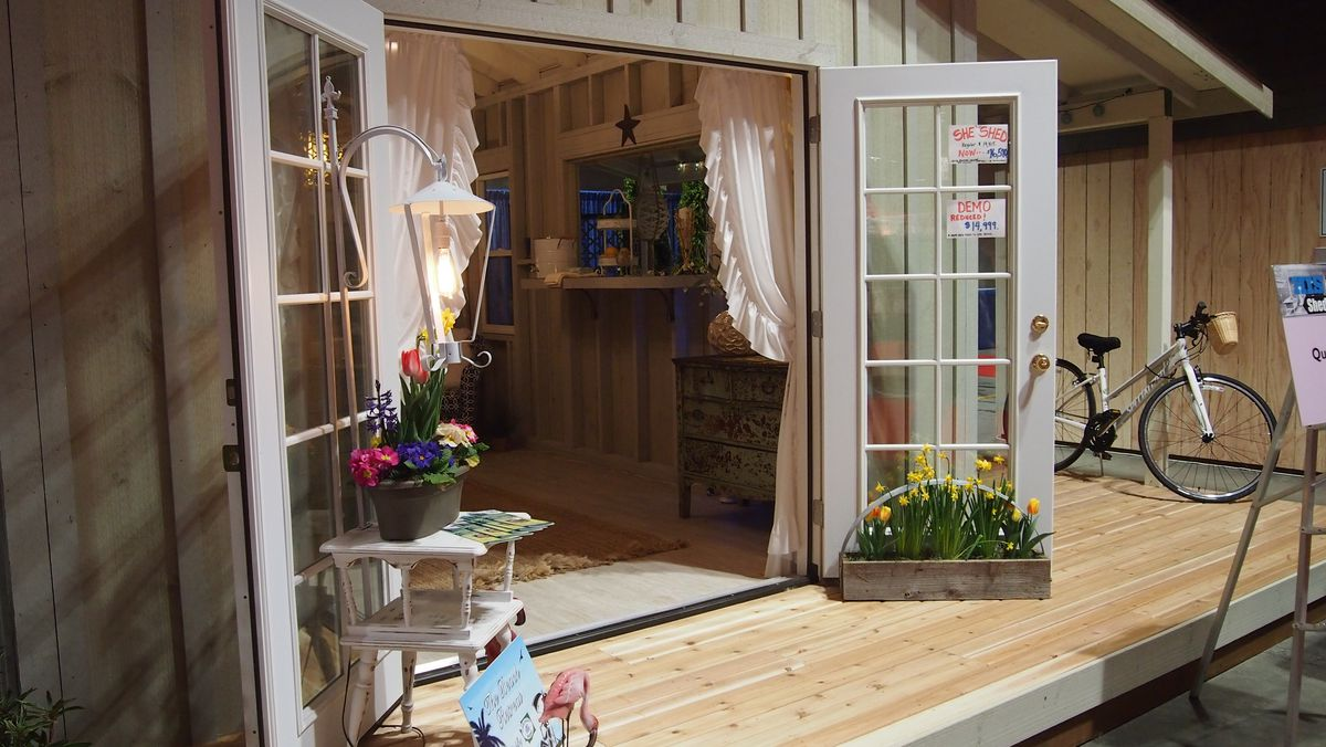 French doors and curtains lead the way into a shed