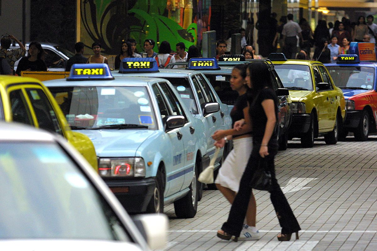 Taxis on a street in Singapore