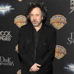 """Tim Burton, director of the upcoming film """"Dark Shadows,"""" poses backstage following Warner Bros.' presentation at CinemaCon 2012, the official convention of the National Association of Theater Owners, Tuesday, April 24, 2012, in Las Vegas."""