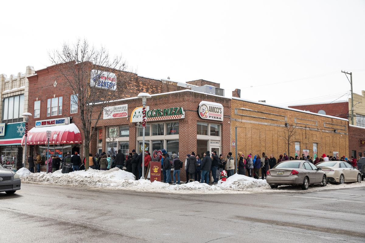A line of people outside of New Palace Bakery in Hamtramck wraps around the block on Fat Tuesday 2018.