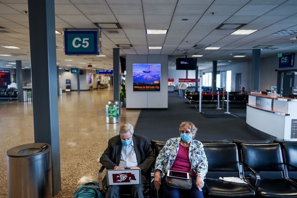 Norm Scott, 83, and his wife, Sharon Scott, 79, wait during a layover at Salt Lake City International Airport on their way from Tucson, Ariz., to Ithaca, N.Y., on Thursday, April 30, 2020. Like airports all over the world, Salt Lake's airport has seen air traffic plummet due to the COVID-19 pandemic.