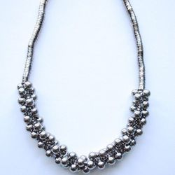 """<a href=""""http://www.shopvonz.com/collections/necklaces/products/bubble-ball-necklace"""">Bubble Ball Necklace</a>, $28"""