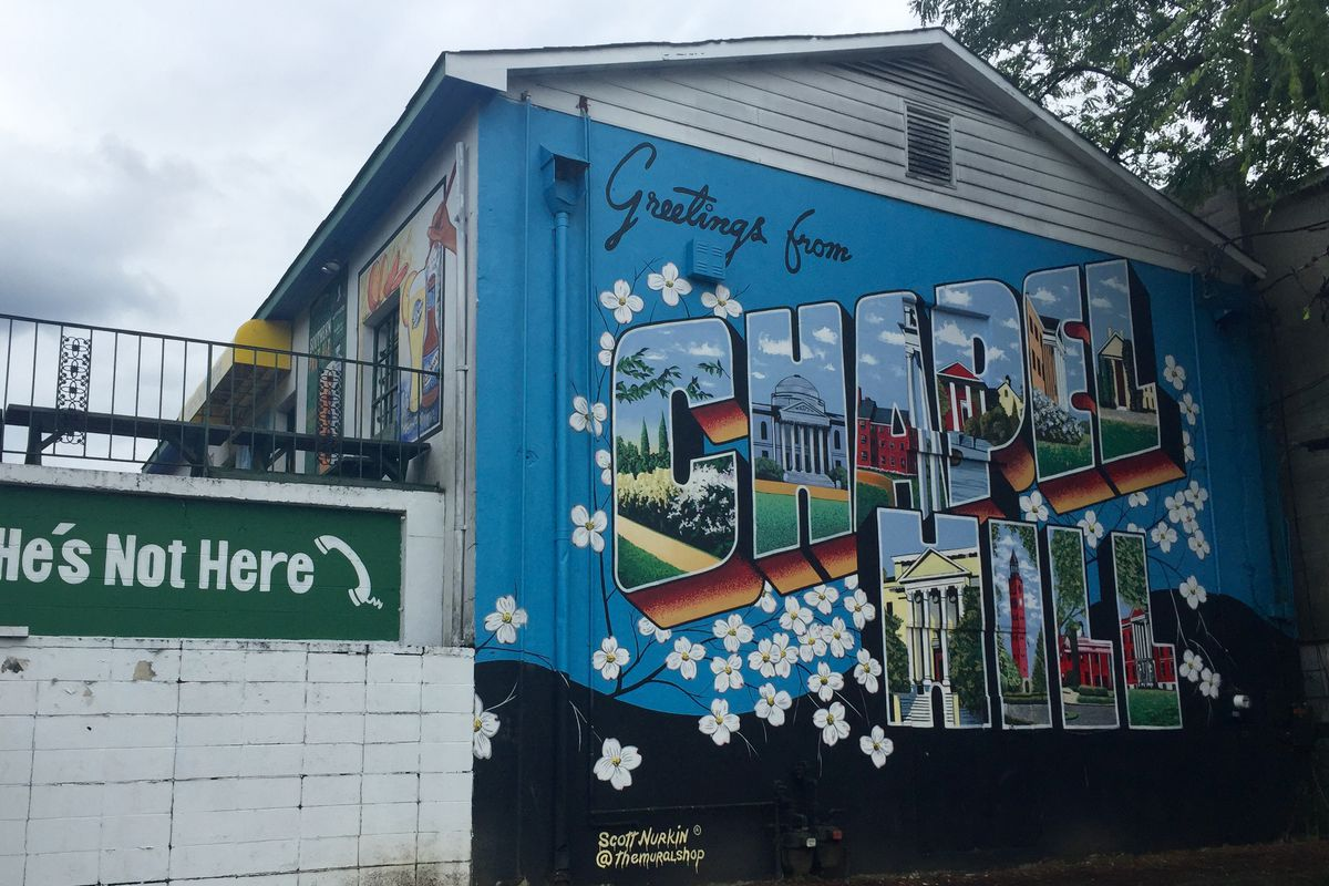 Public art mural outside of He's Not Here in Chapel Hill