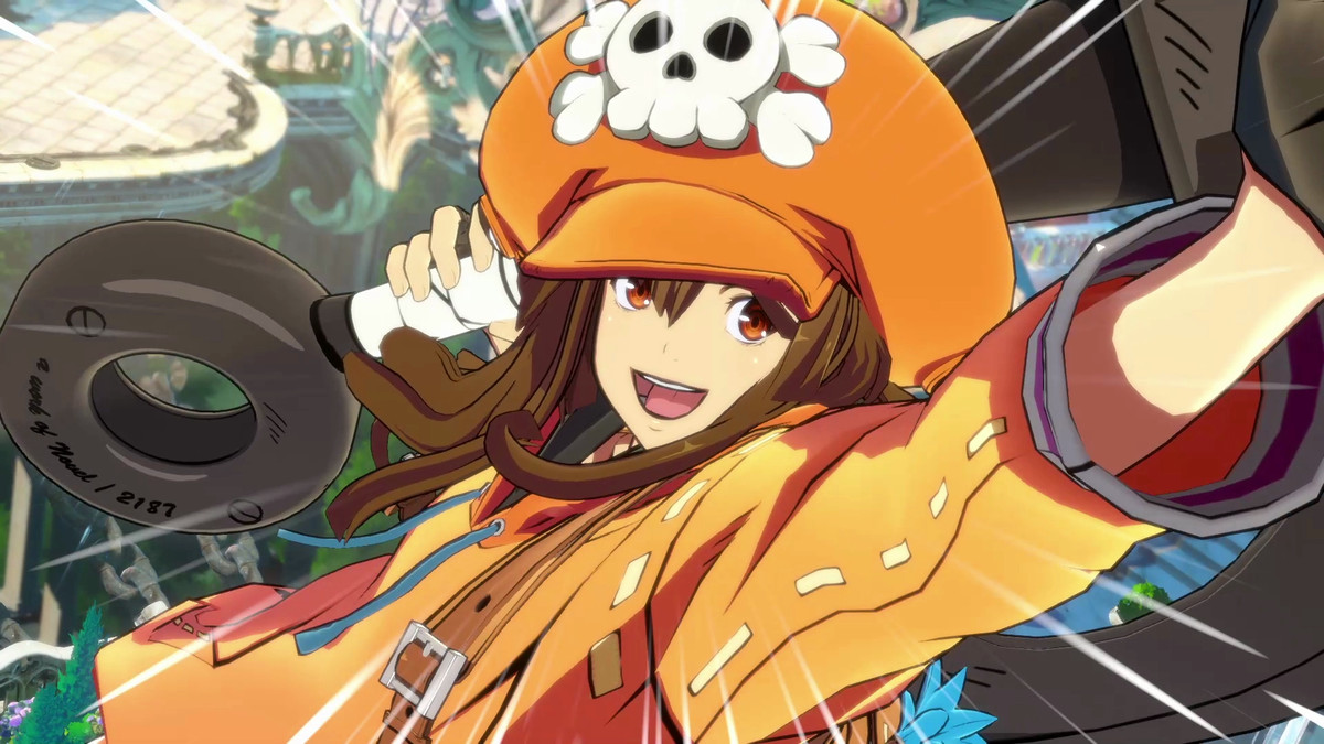 Guilty Gear character May is smiling at the camera and wearing a bright orange outfit