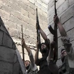 In this image made from video and accessed Saturday, Sept. 1, 2012, Free Syrian Army fighters raise their weapons during fighting with the Syrian Army in Aleppo, Syria. Syrian troops bombarded the northern city of Aleppo Saturday with warplanes and mortar shells as soldiers clashed with rebels in different parts of Syria's largest city, activists said. The Britain-based Syrian Observatory for Human Rights said the clashes were concentrated in several tense neighborhoods where some buildings were damaged and a number of people were wounded. (AP Photo via AP video)