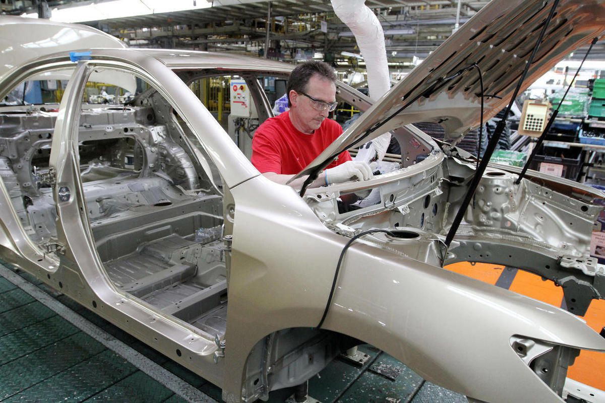 FILE - In this Feb. 25, 2010 file photo, production team member Darryl Ashley installs an inner dash silencer in a Camry on the assembly line at the Toyota Motor Manufacturing plant in Georgetown, Ky. For the first time in more than 20 years, U.S. automak