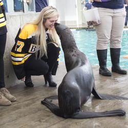 Boston Blades forward Nicole Giannino gets a kiss from Ursula.