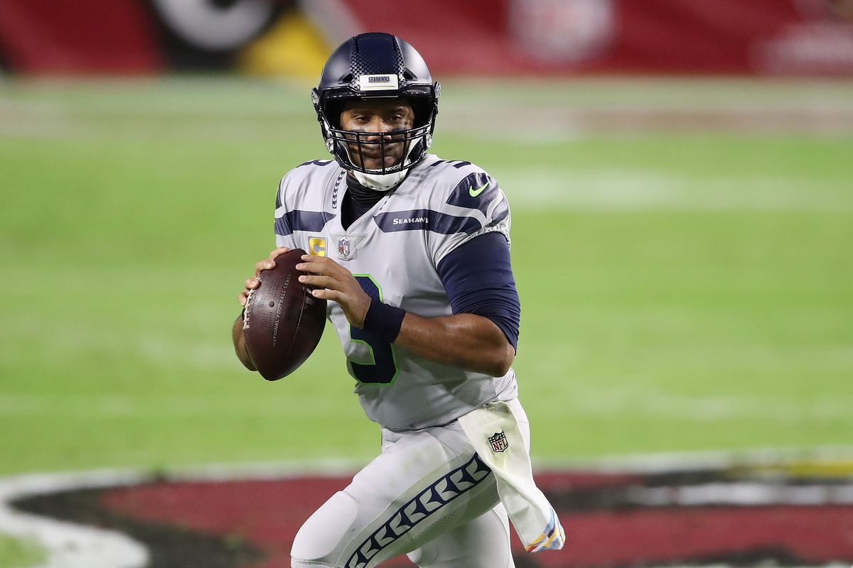 Quarterback Russell Wilson #3 of the Seattle Seahawks looks to pass during the NFL game against the Arizona Cardinals at State Farm Stadium on October 25, 2020 in Glendale, Arizona.
