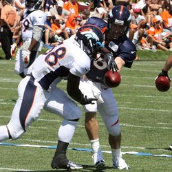 Broncos rookie RB Montee Ball takes a hand off from Peyton Manning during drills