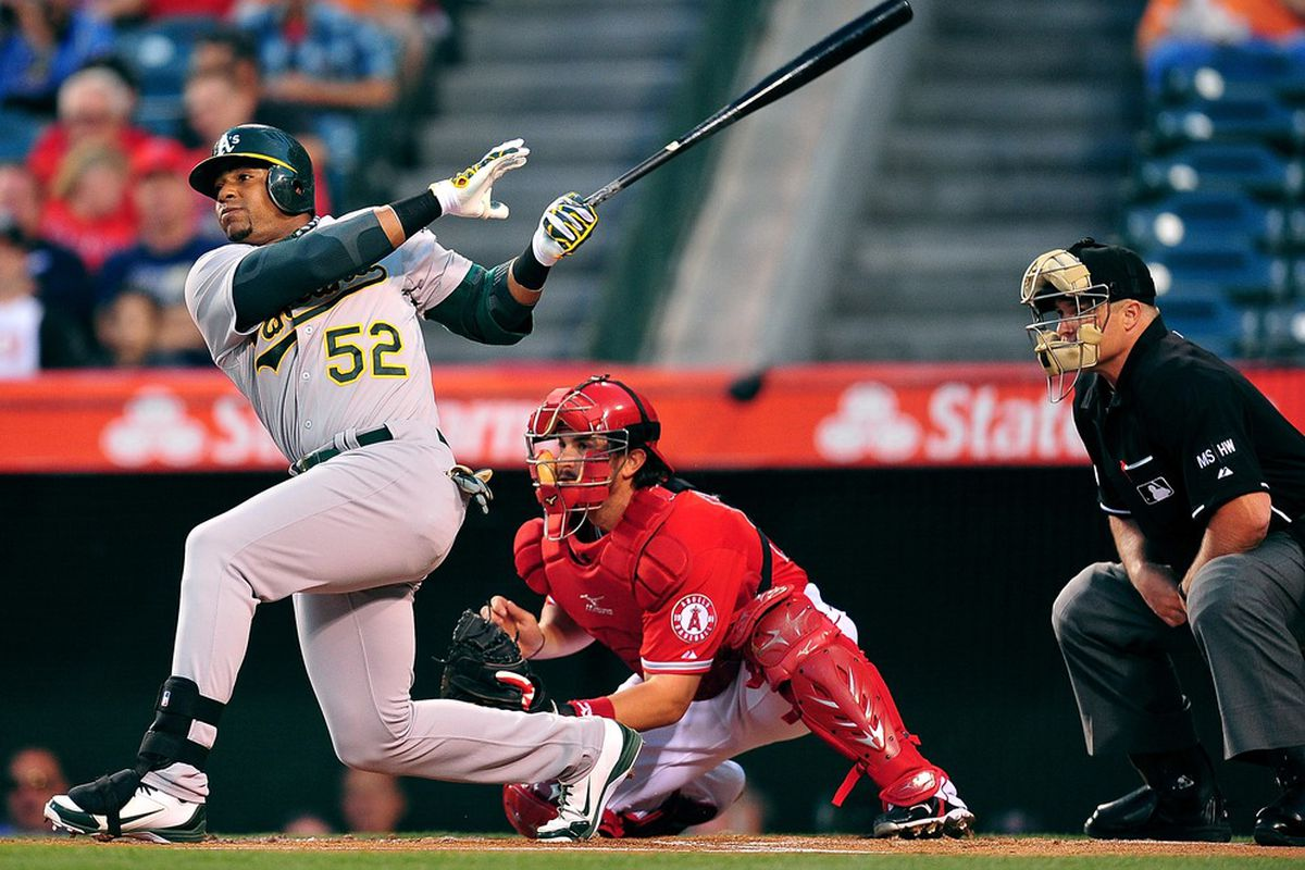 April 18, 2012; Anaheim, CA, USA; Oakland Athletics center fielder Yoenis Cespedes (52) hits a three run home run in the first inning against the Los Angeles Angels at Angel Stadium. Mandatory Credit: Gary A. Vasquez-US PRESSWIRE