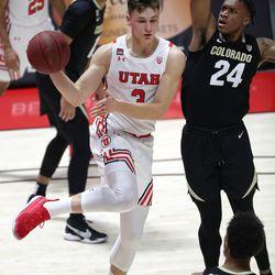 Utah Utes guard Pelle Larsson (3) passes the ball as Colorado Buffaloes guard Eli Parquet (24) guards him during a men's basketball game at the Huntsman Center in Salt Lake City on Monday, Jan. 11, 2021. Utah lost 58-65.