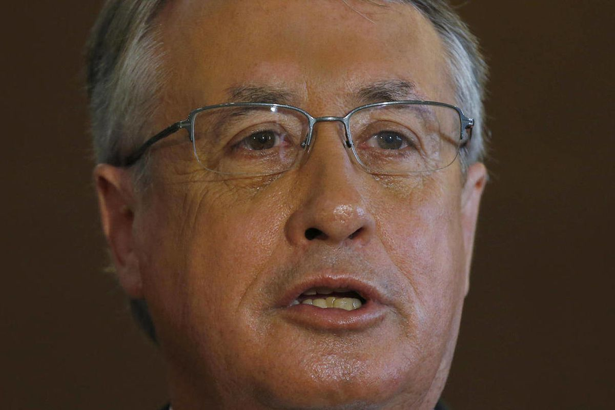 """FILE - In this July 11, 2012 file photo, Australia's Deputy Prime Minister and Treasurer Wayne Swan speaks to the media after delivering a speech at the """"RMB Cross-border Trade and Investment Forum"""" in Hong Kong. Swan warned Friday, Sept. 21, 2012 that th"""